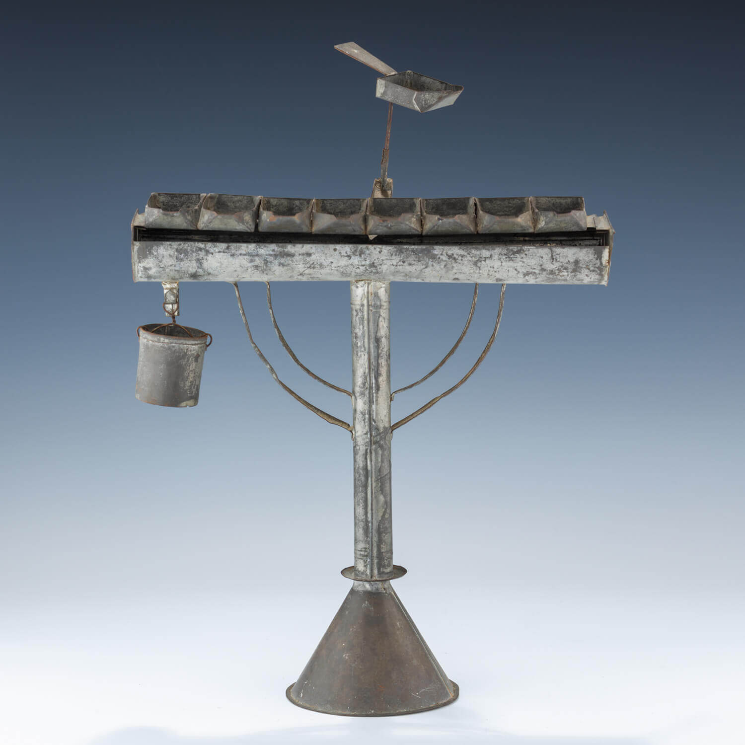 137. A RARE AND IMPORTANT TIN HANUKKAH MENORAH
