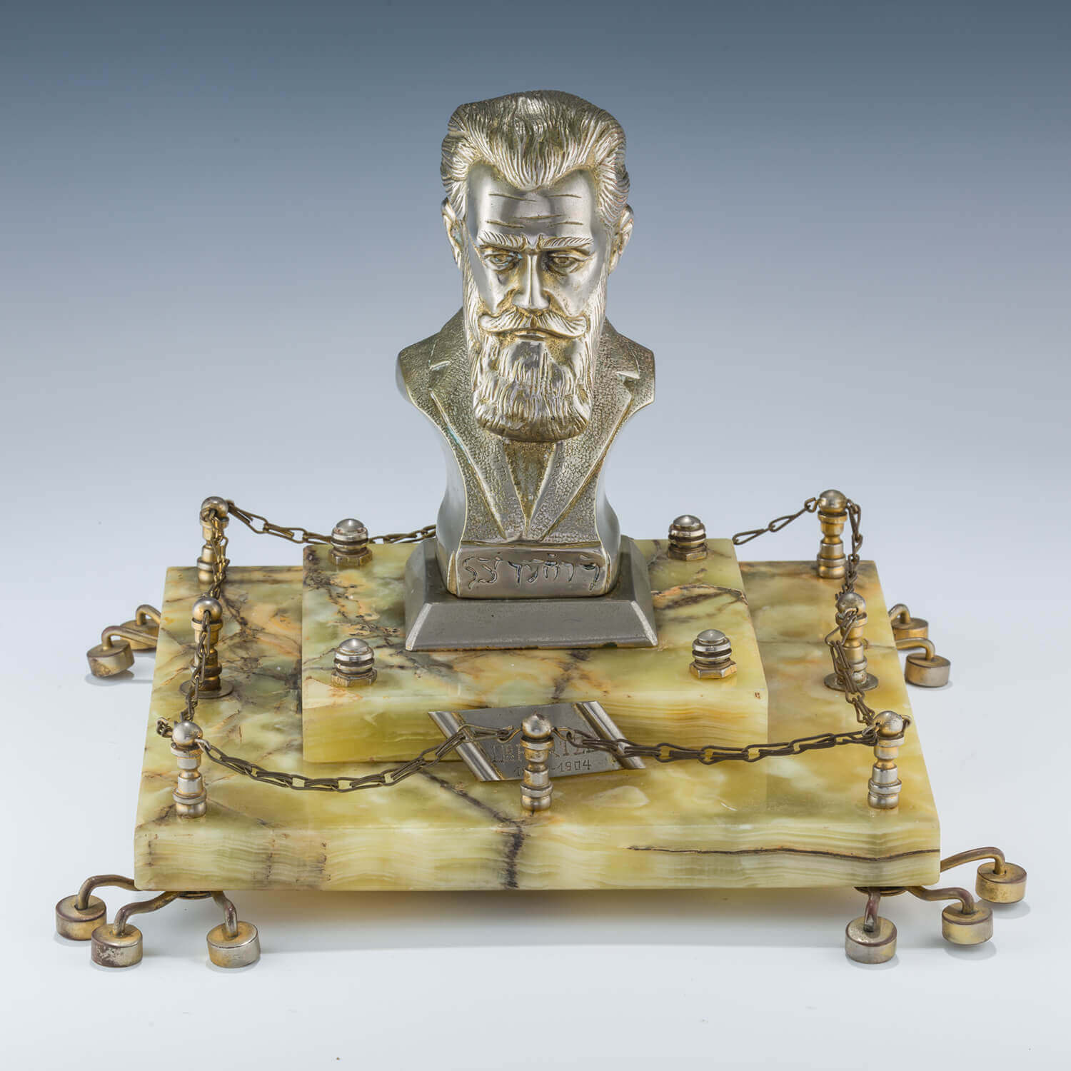 127. AN IMPORTANT MARBLE MOUNTED BRASS SCULPTURE OF THEODOR HERZL