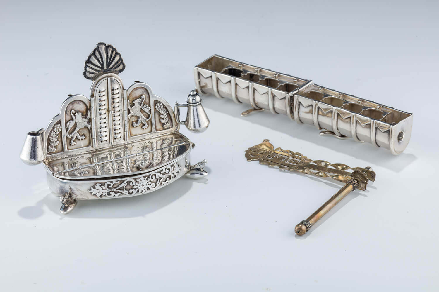 164. TWO SILVER TRAVELLING HANUKKAH LAMPS