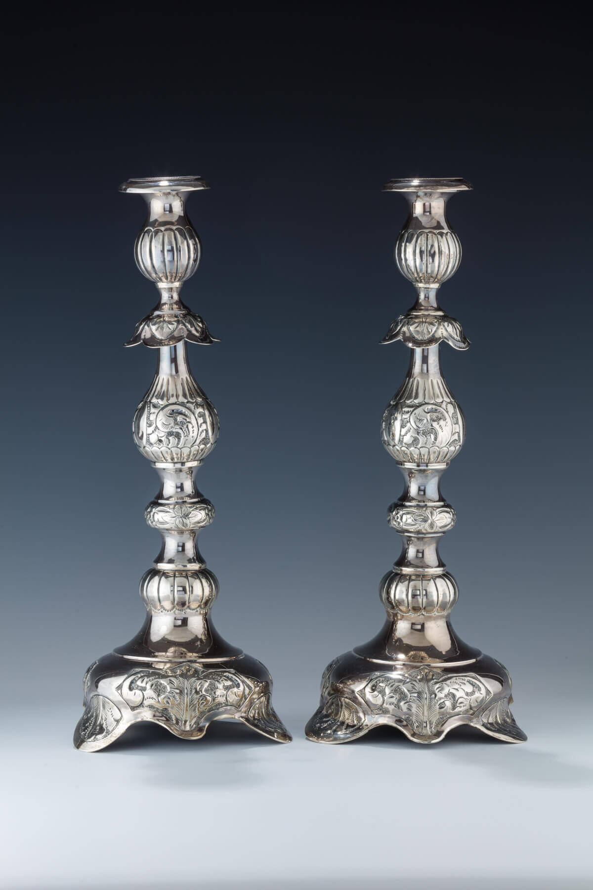 021. FOUR STERLING SILVER SABBATH CANDLESTICKS