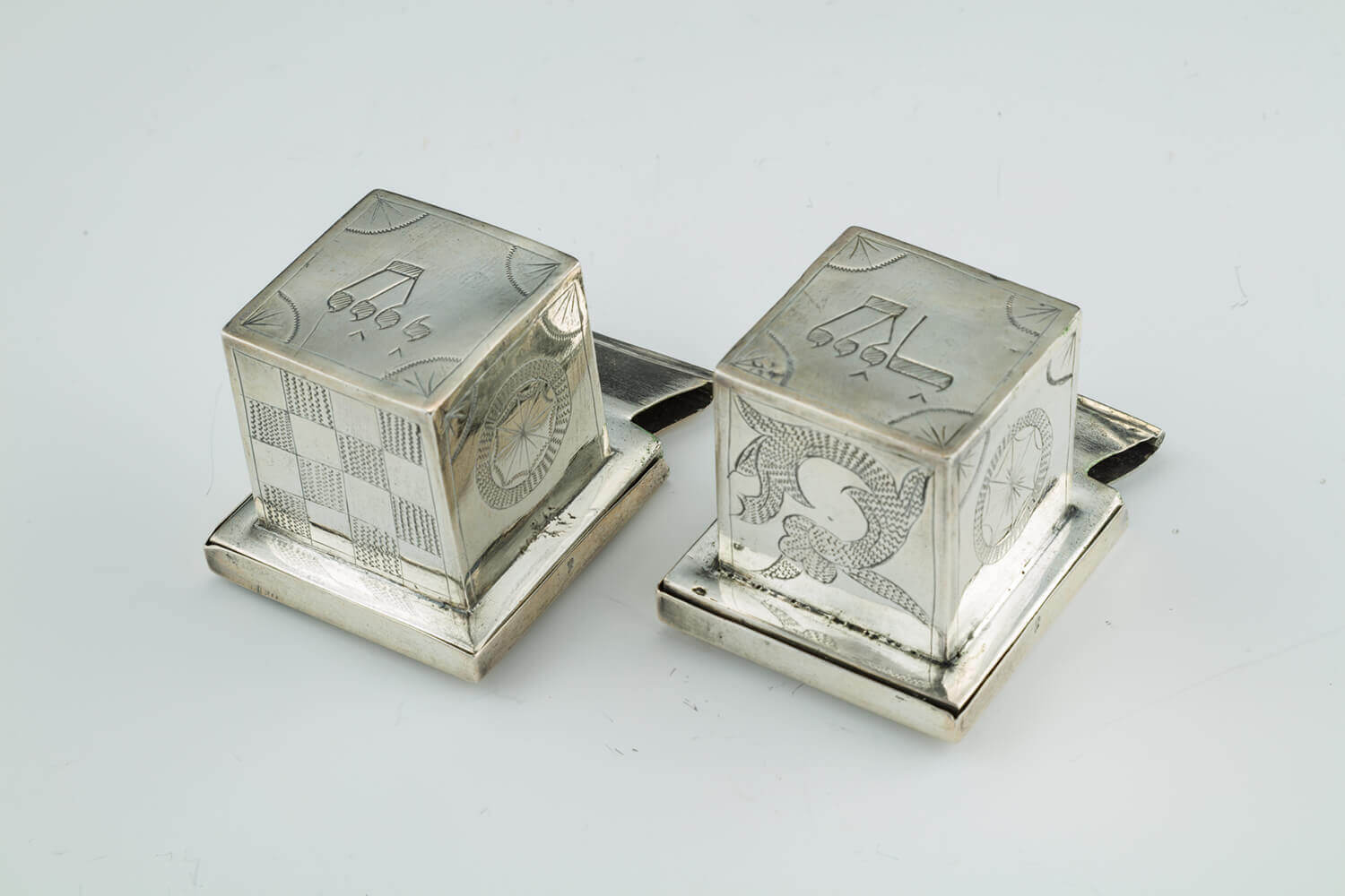080. A RARE AND IMPORTANT PAIR OF SILVER TEFILLIN CASES