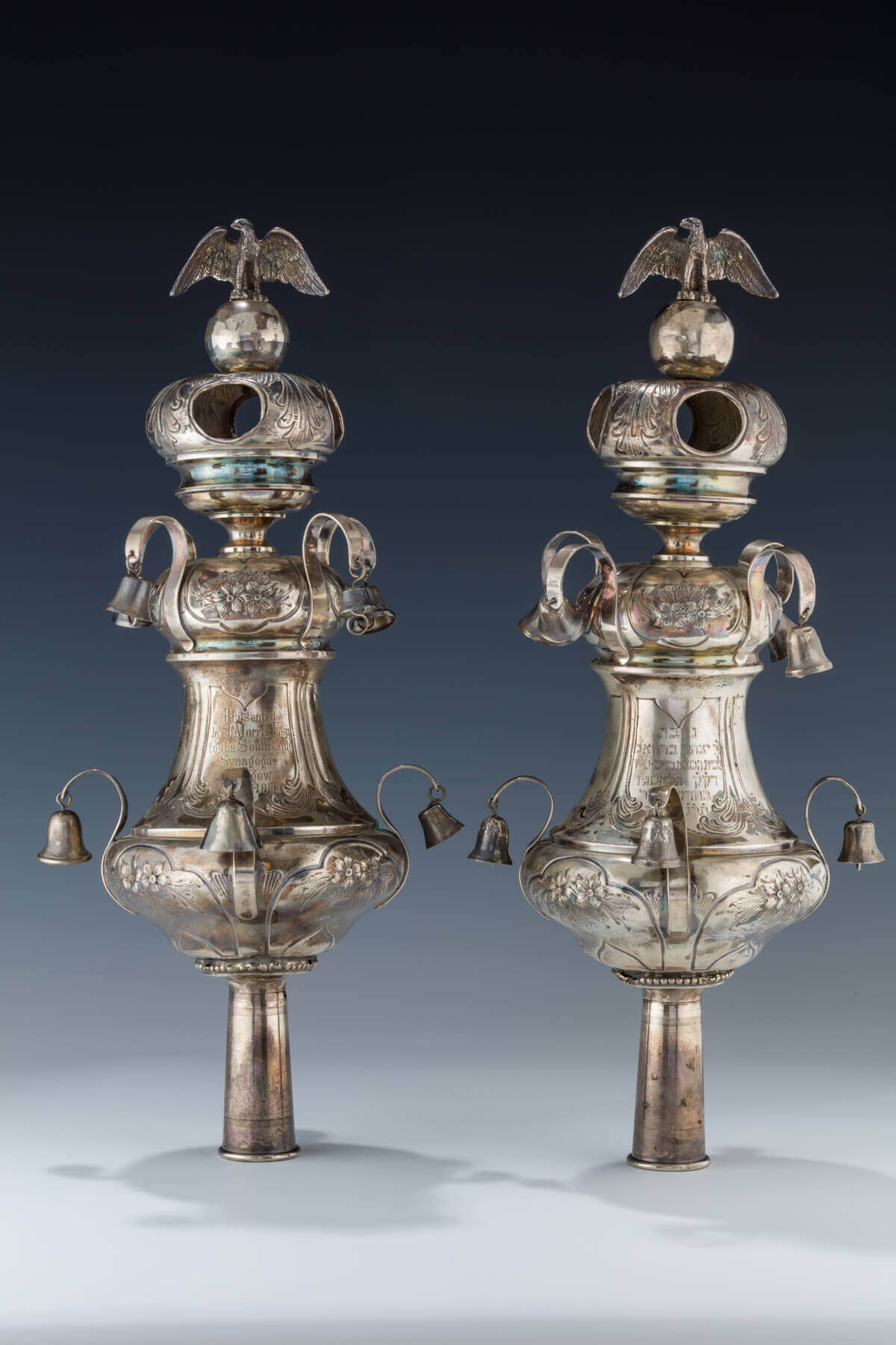 056. A PAIR OF LARGE SILVER TORAH FINIALS