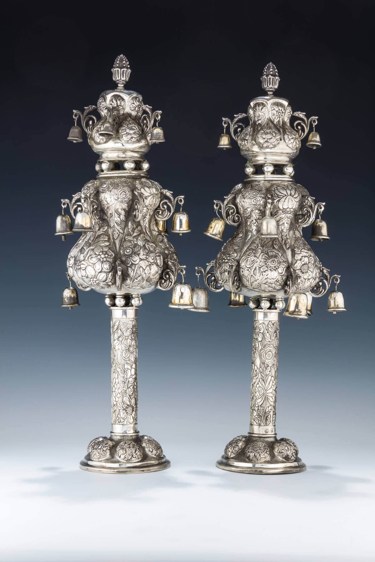 150. A MONUMENTAL PAIR OF SILVER TORAH FINIALS