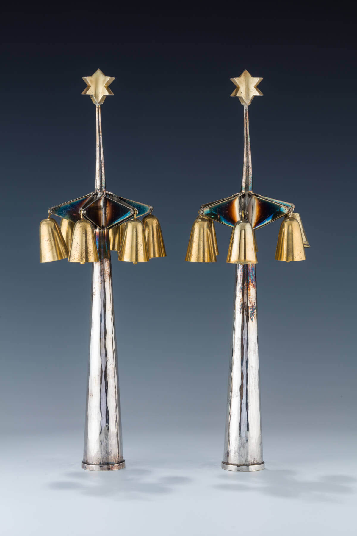 055. A PAIR OF SILVER TORAH FINIALS