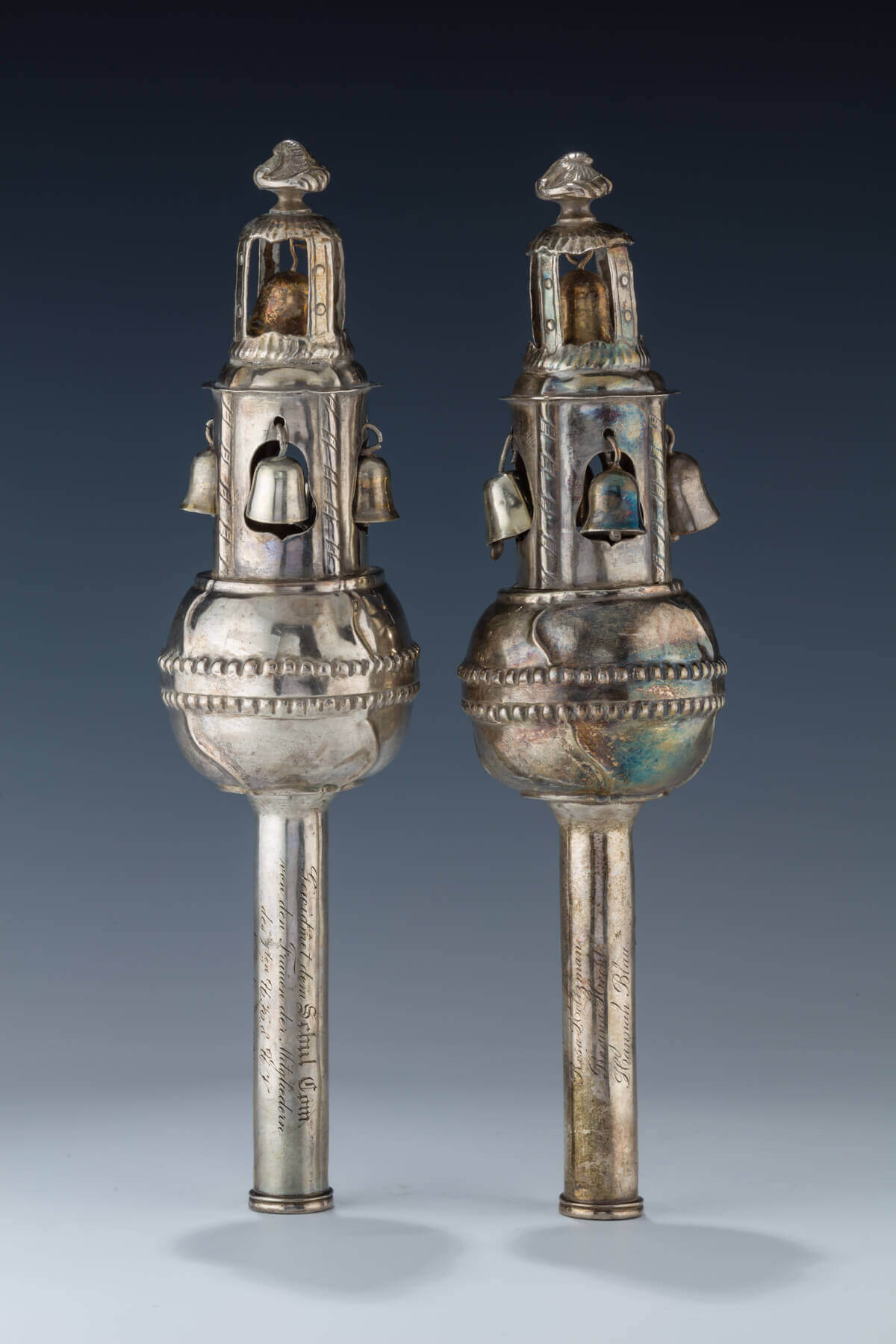 130. A RARE PAIR OF SILVER TORAH FINIALS