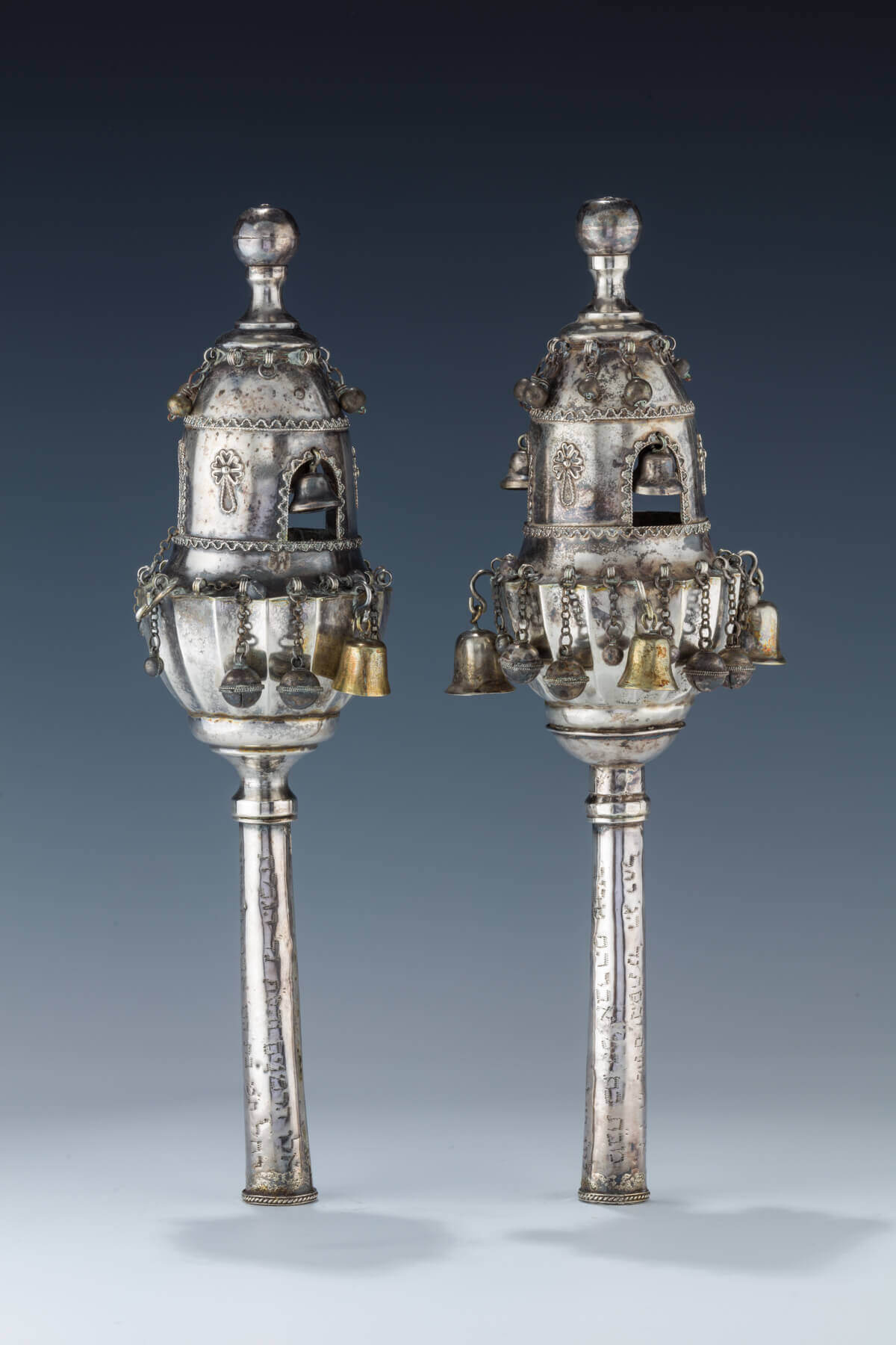 047. A PAIR OF SILVER TORAH FINIALS
