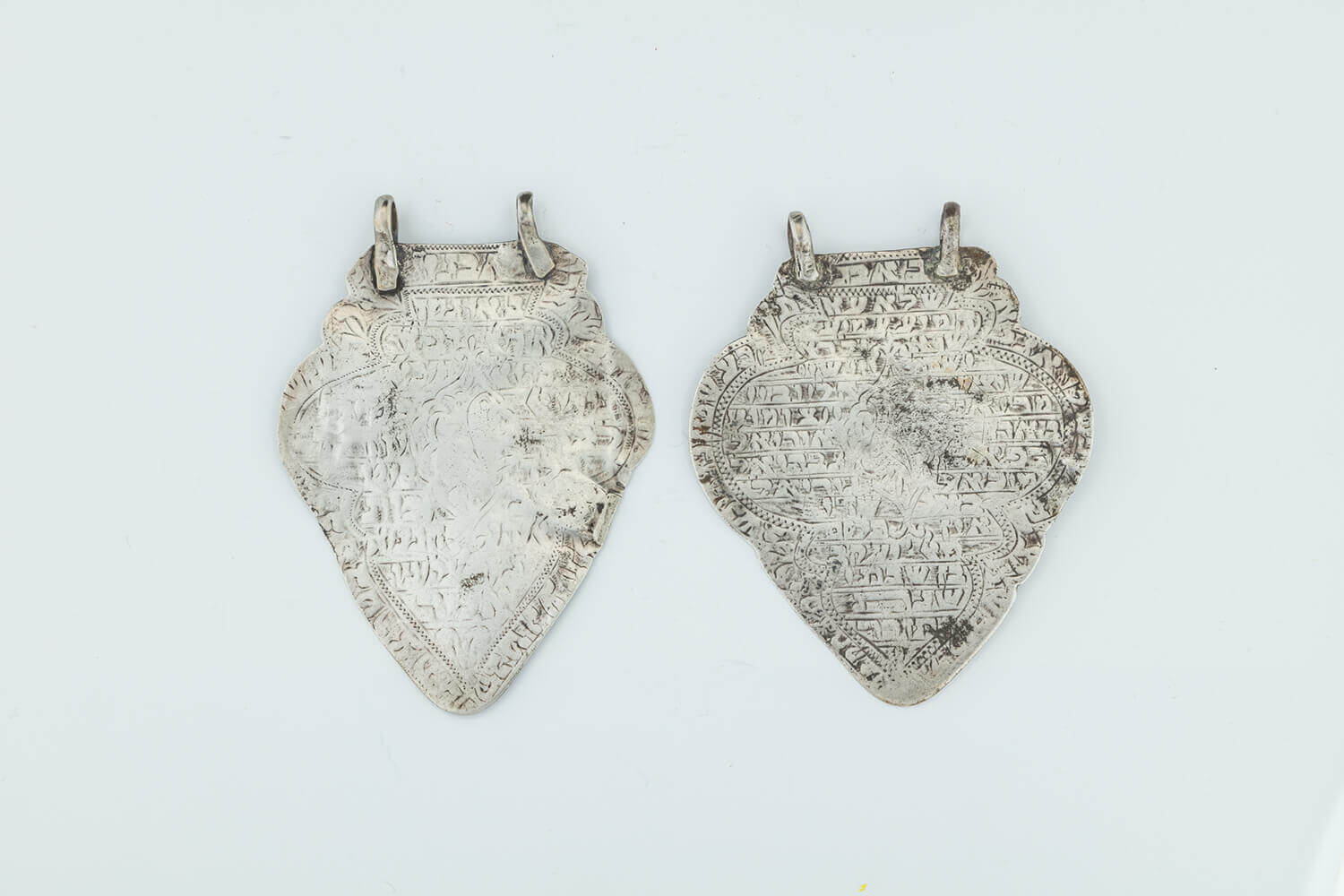 008. TWO EARLY SILVER AMULETS