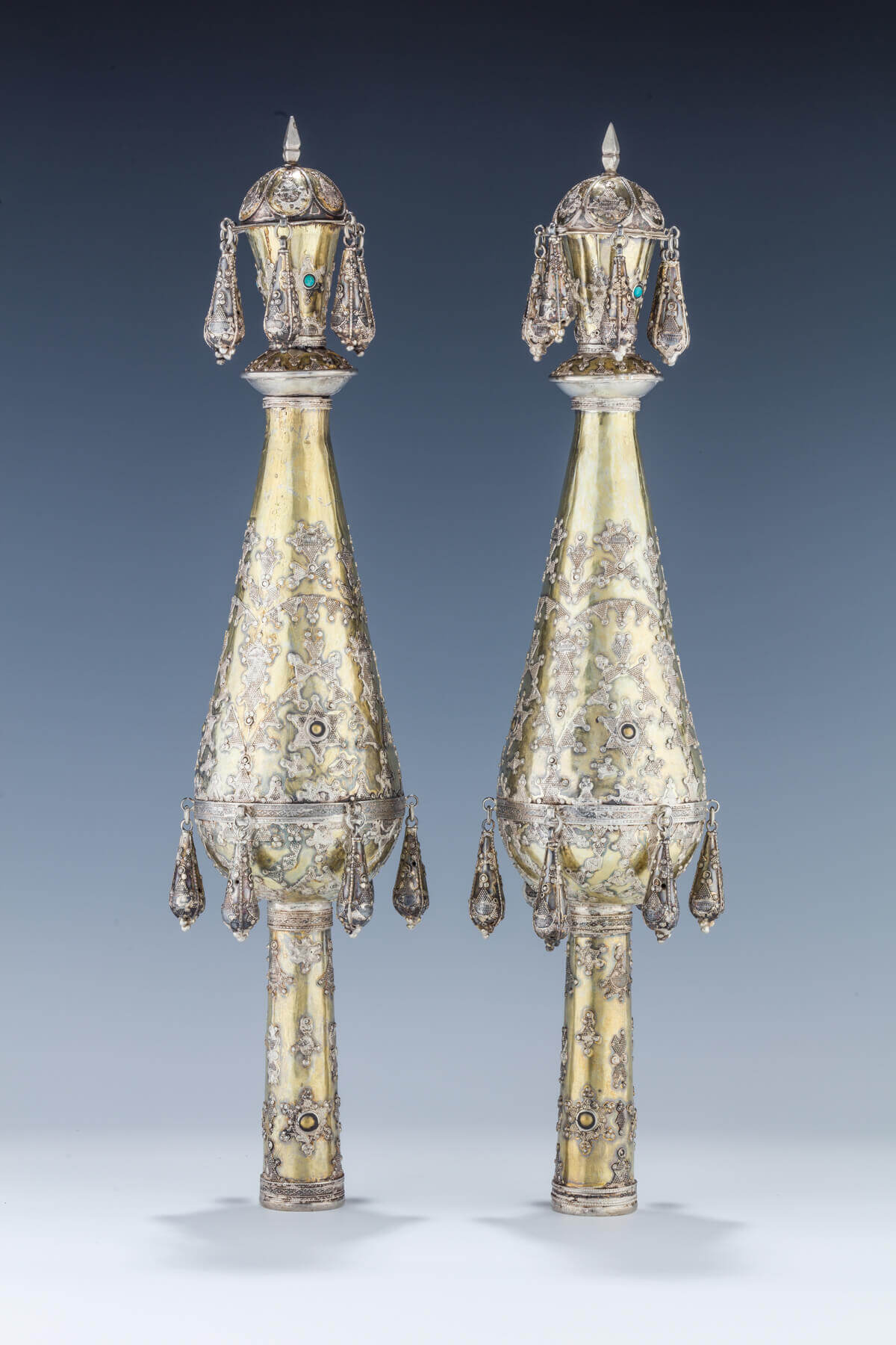 088. A PAIR OF GILDED SILVER TORAH FINIALS