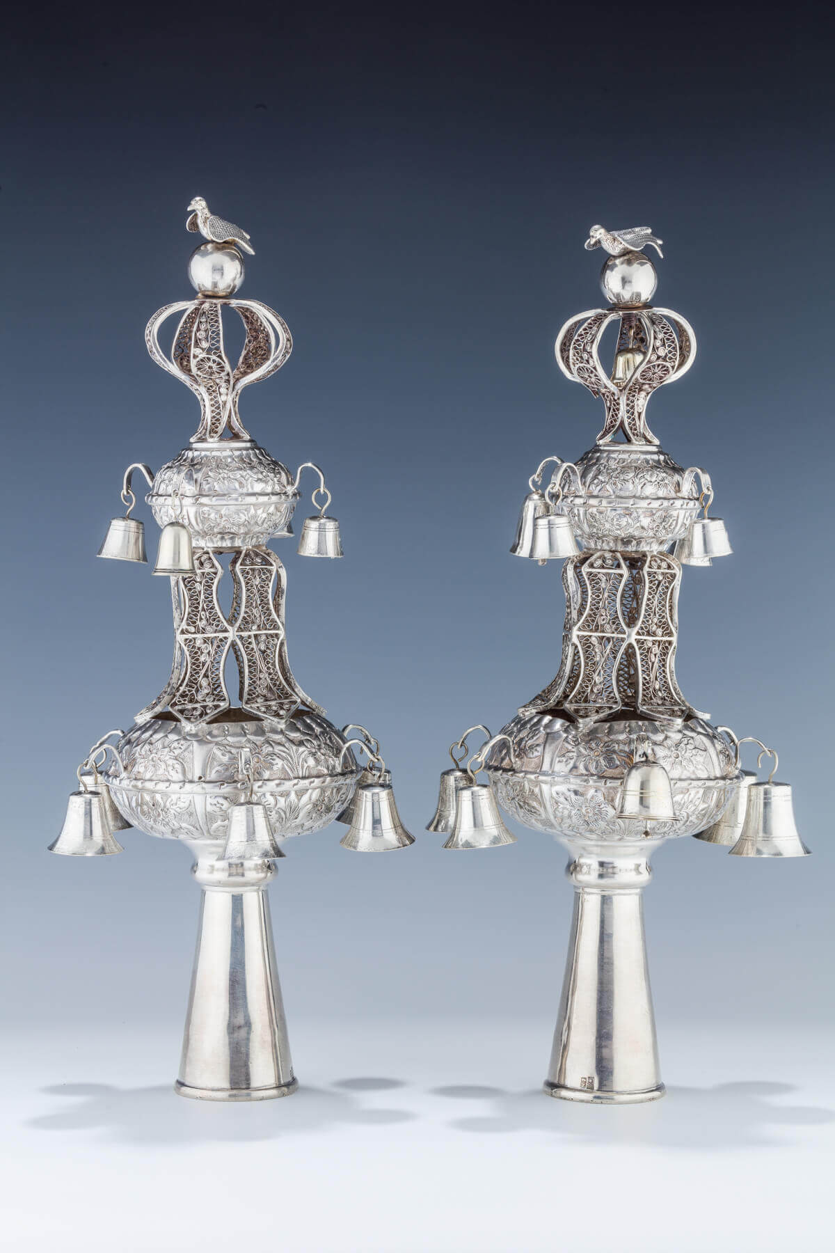 019. A PAIR OF SILVER TORAH FINIALS