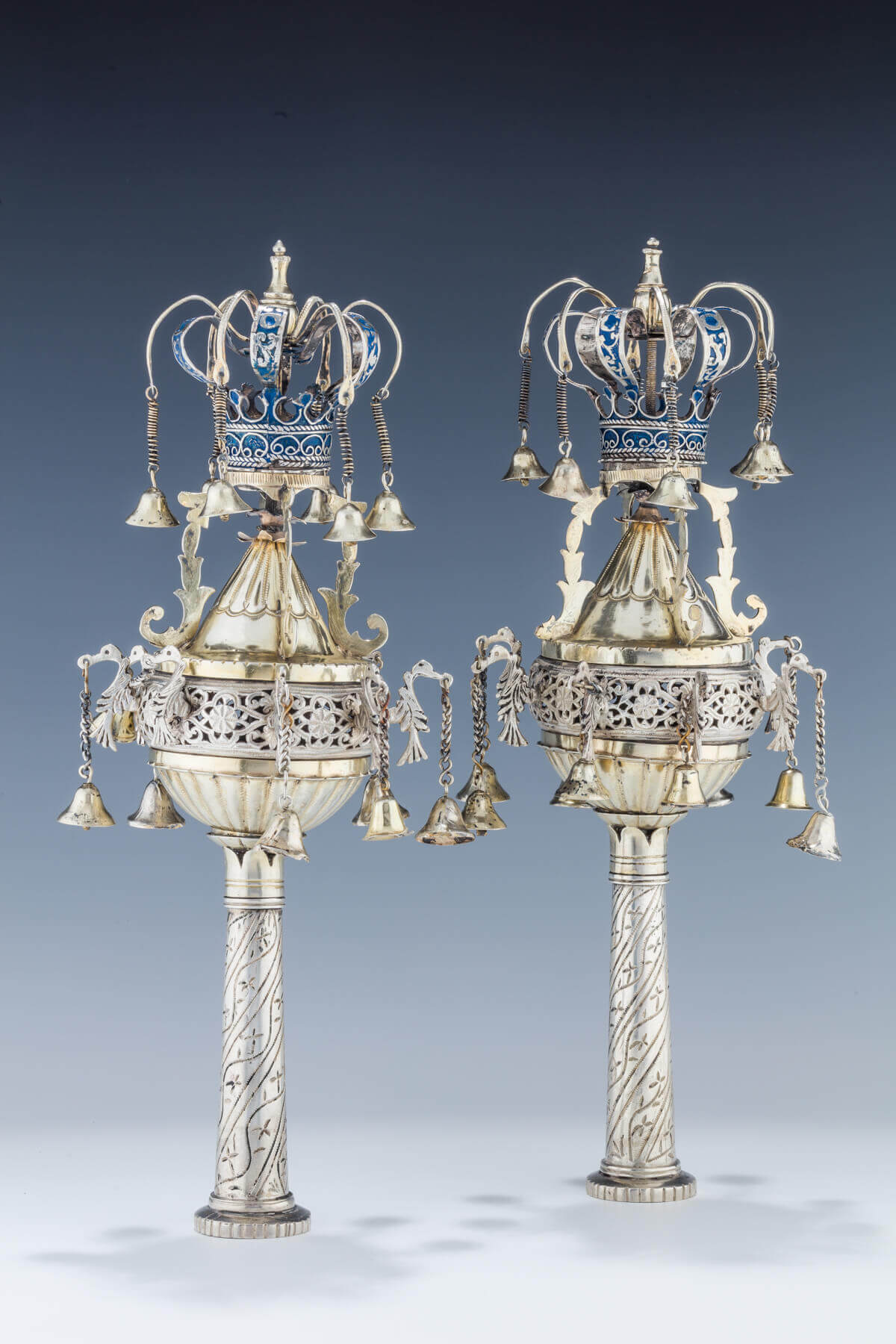 090. A PAIR OF PARCEL GILT TORAH FINIALS