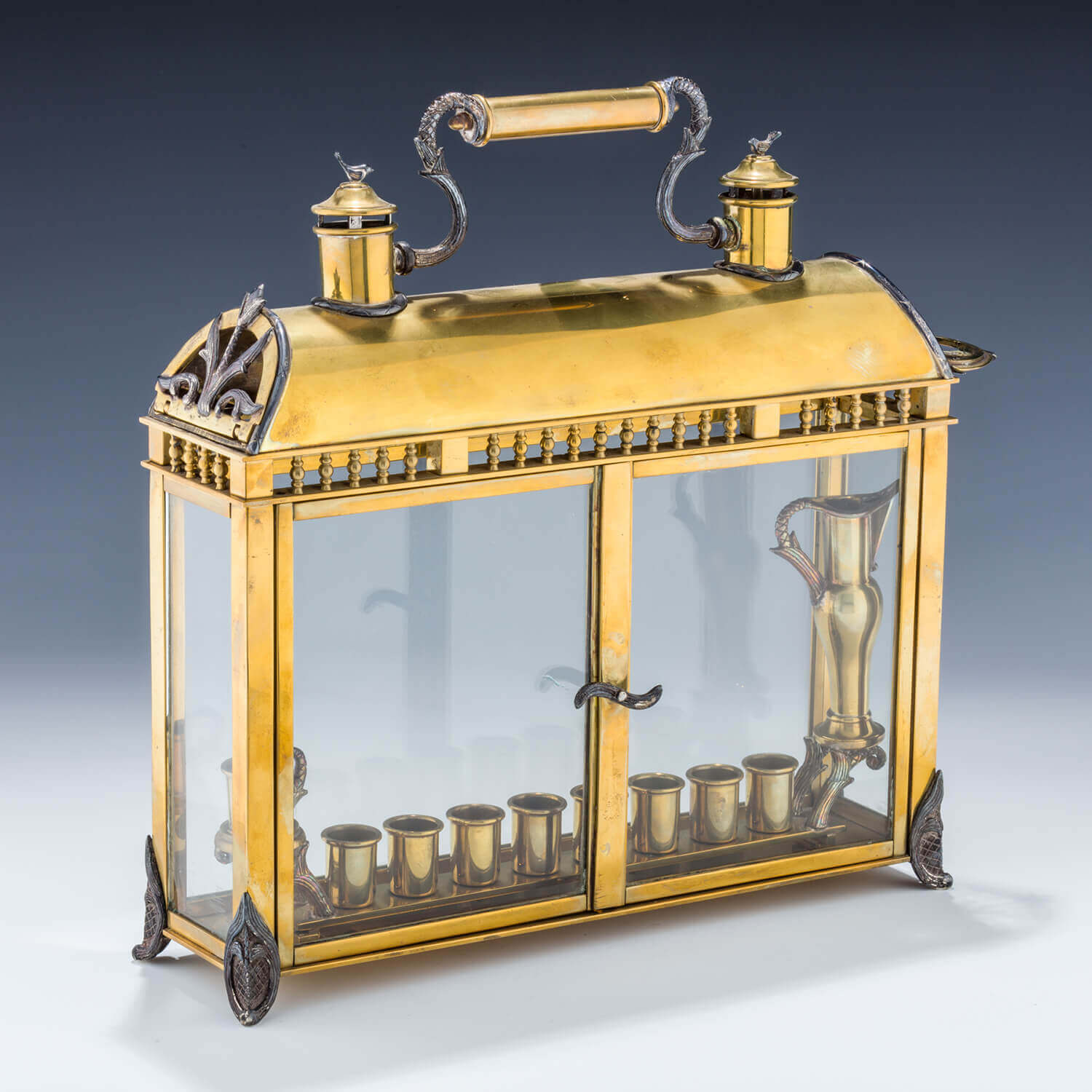 126. A Yossi Swed Silver, Silver-Gilt and Glass Menorah