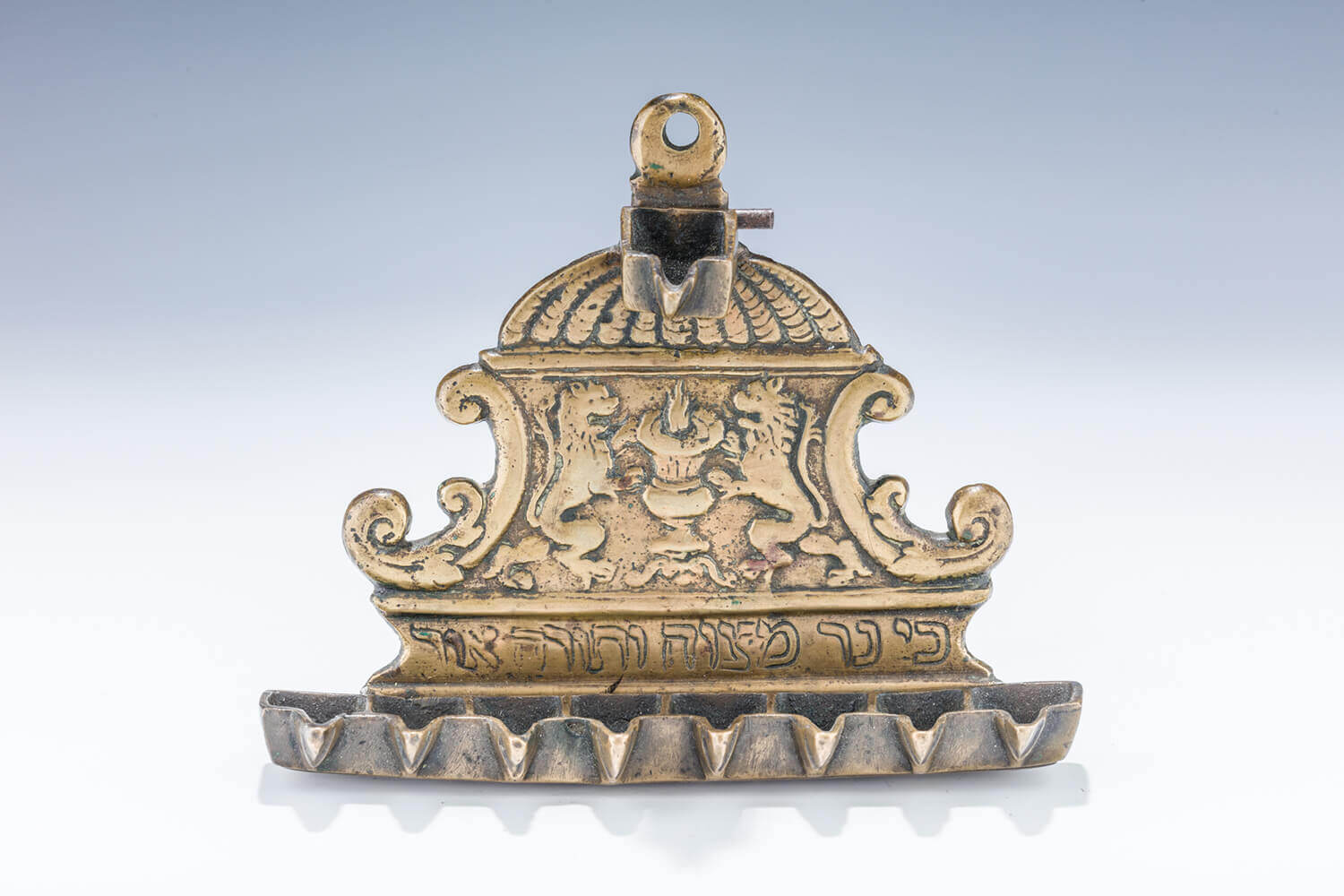 051. AN EARLY AND IMPORTANT BRASS HANUKKAH LAMP