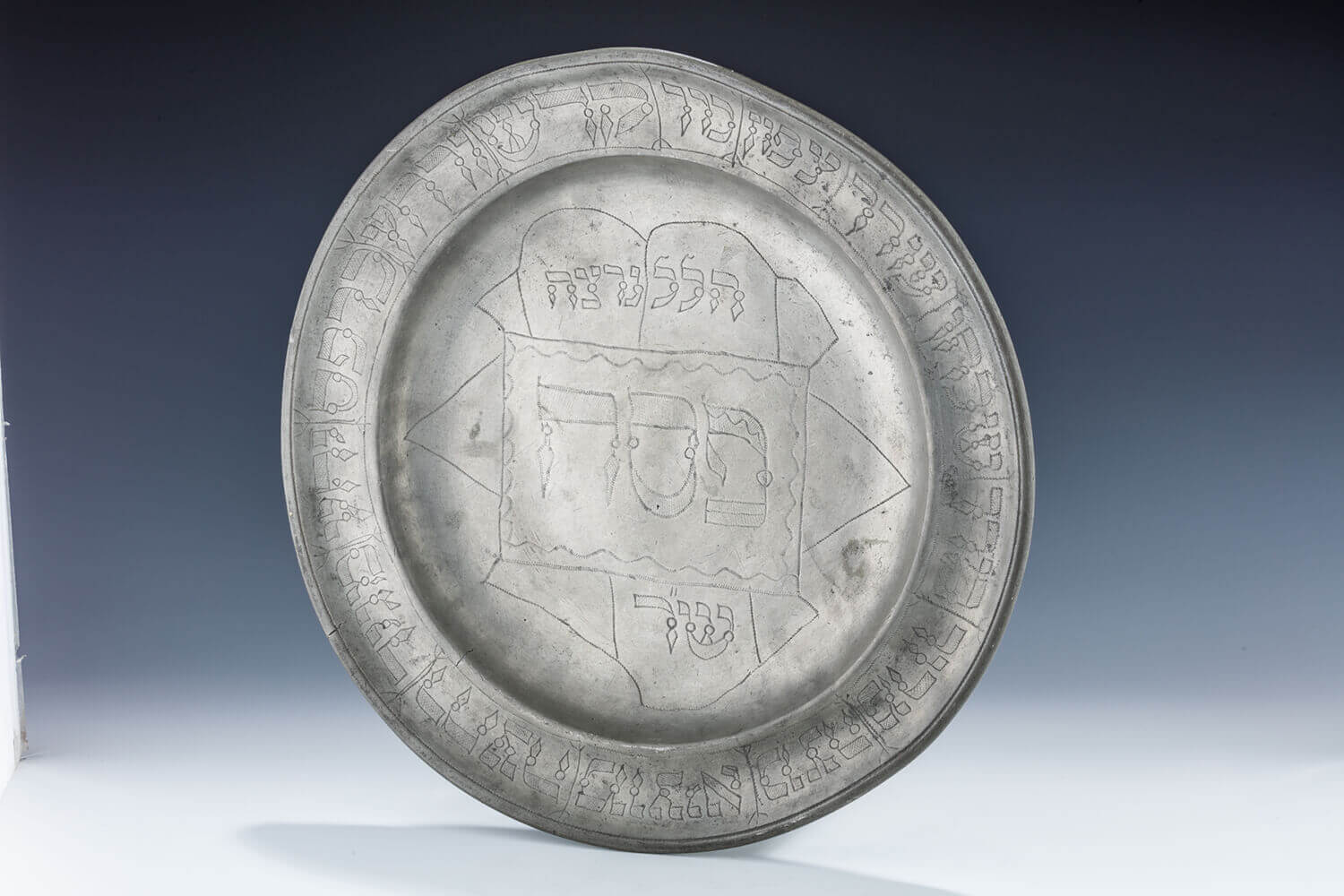 064. A MONUMENTAL PEWTER SEDER TRAY