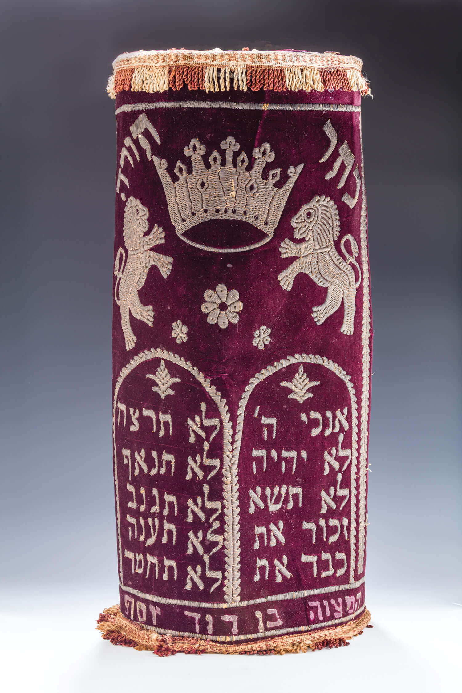 022. A VELVET AND SILVER WIRE TORAH TIK COVER