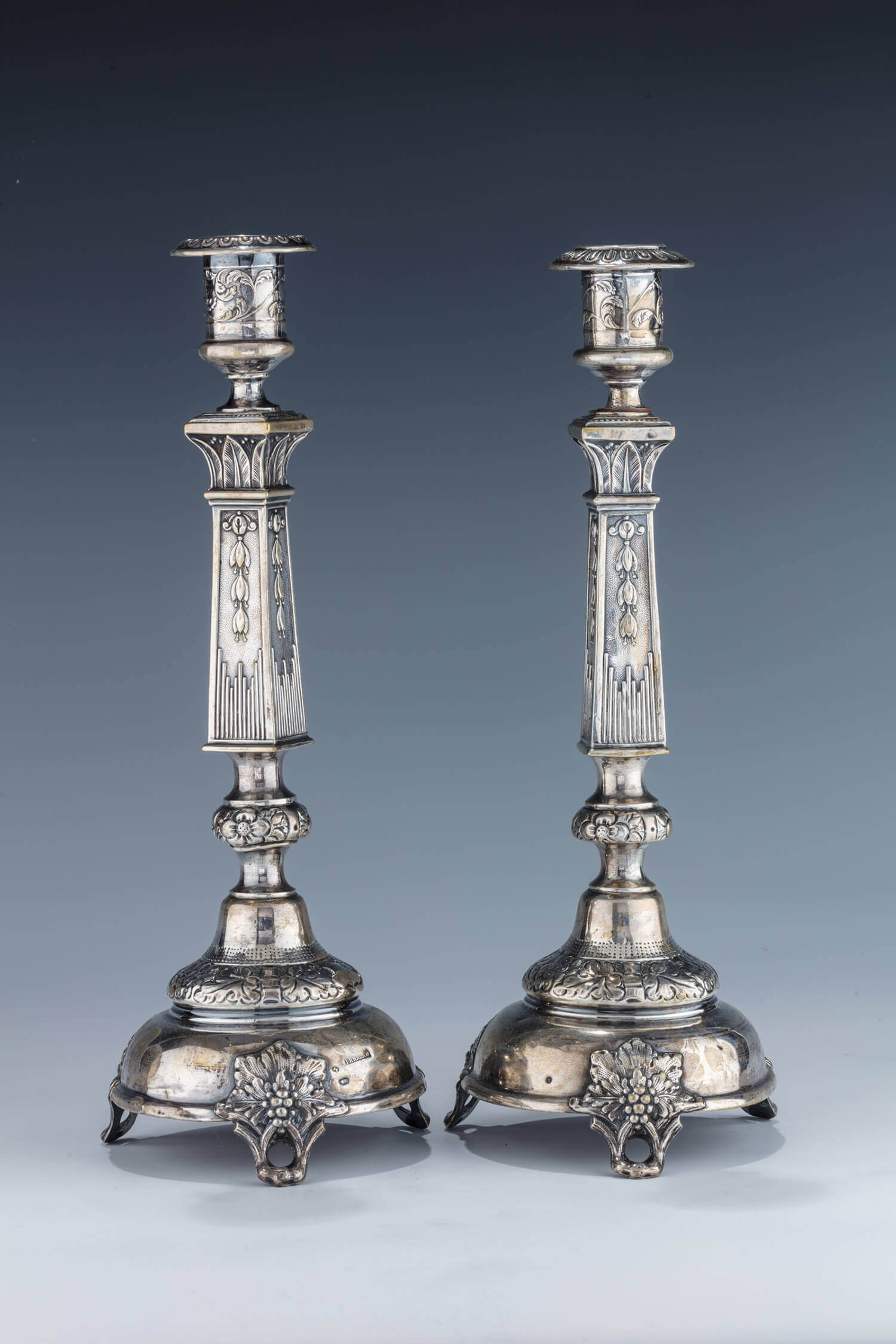 030. A PAIR OF SILVER CANDLESTICKS BY EHRLICH