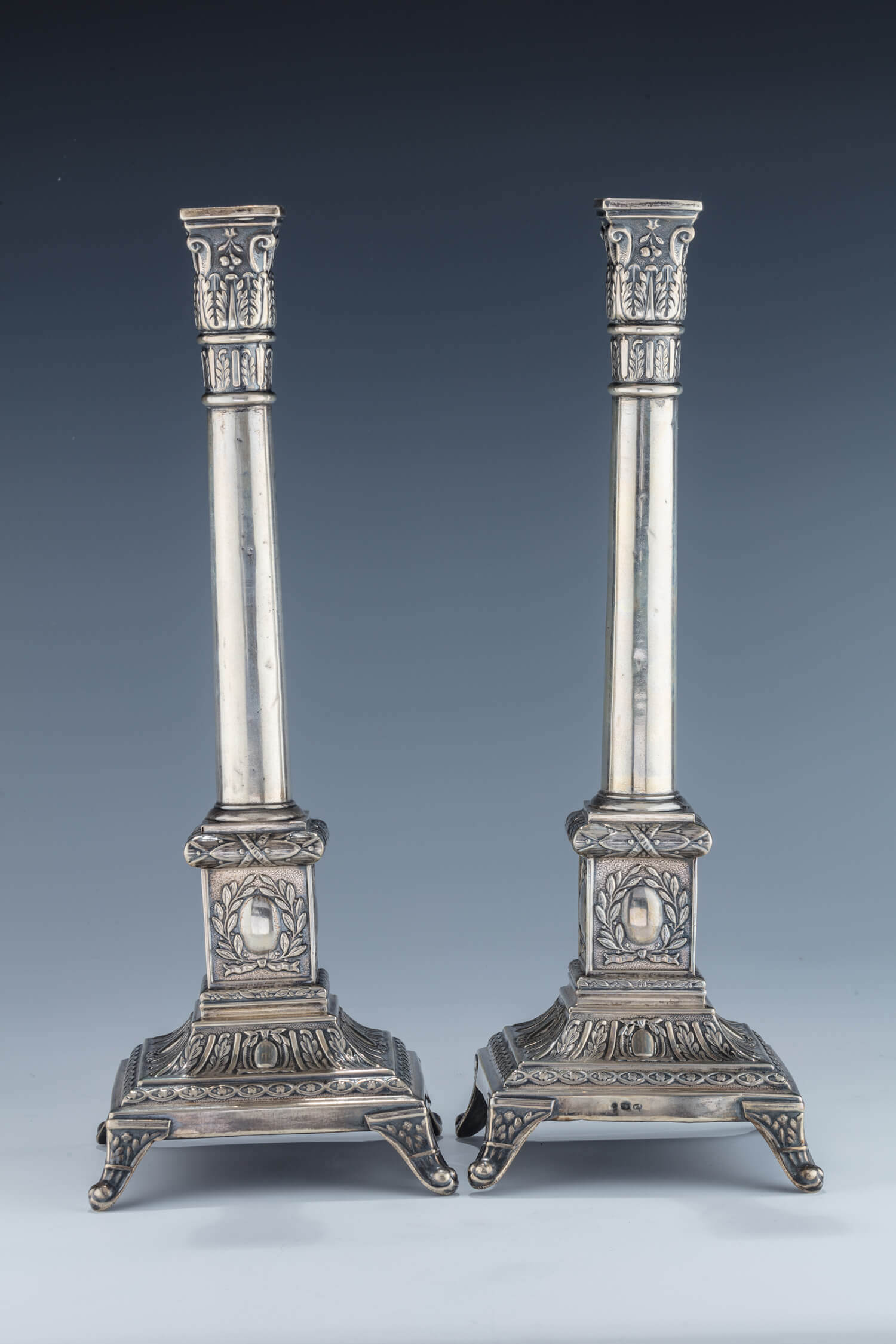 033. A PAIR OF SILVER CANDLESTICKS