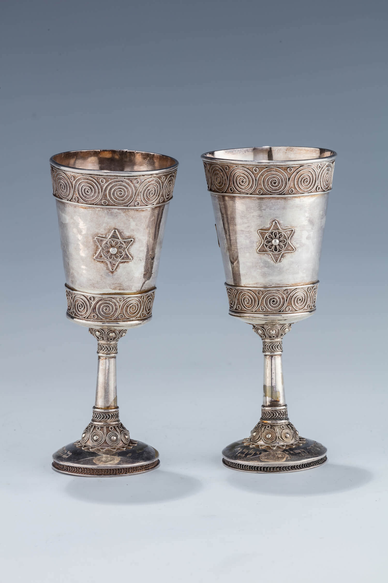 043. A PAIR OF EARLY SILVER KIDDUSH GOBLETS BY THE BEZALEL SCHOOL