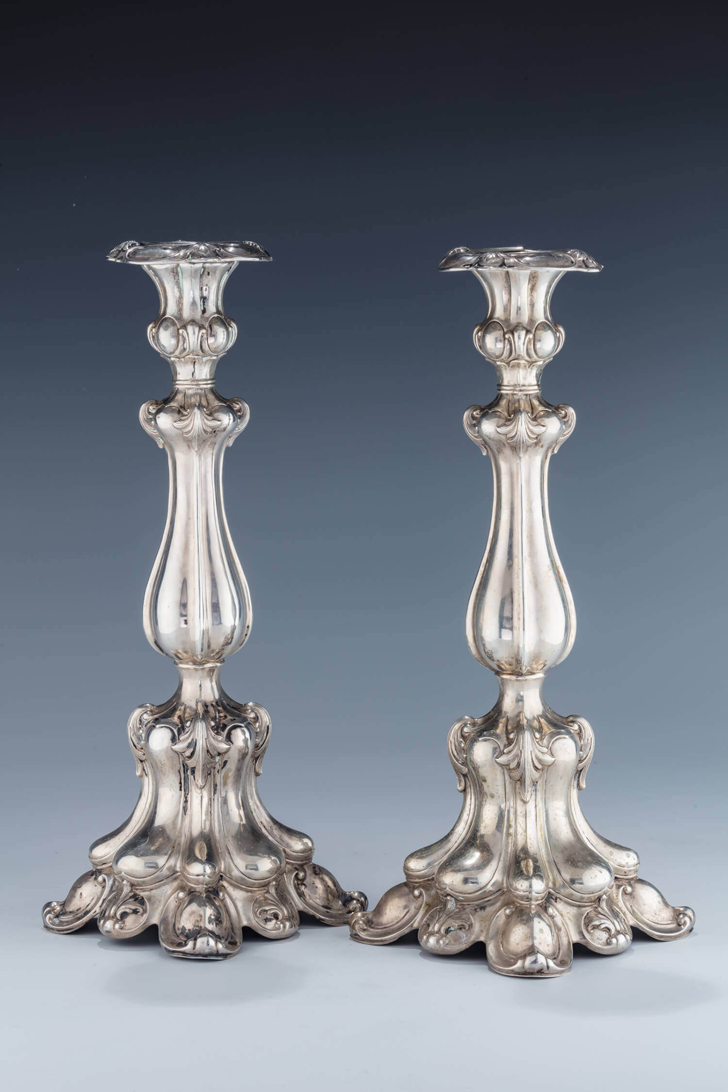 031. A PAIR OF SILVER CANDLESTICKS
