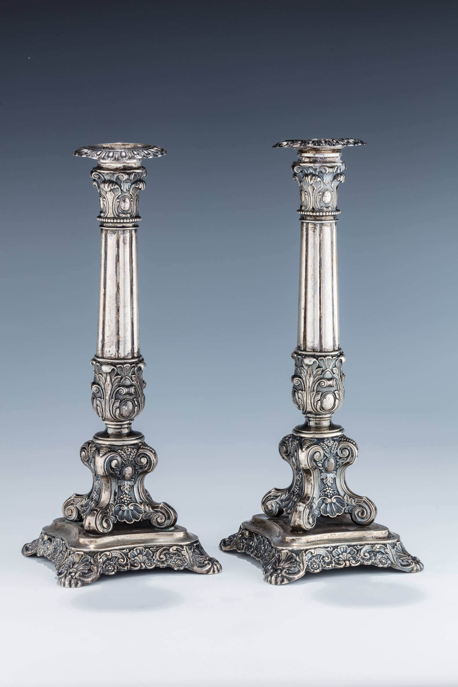 025. A PAIR OF LARGE SILVER CANDLESTICKS