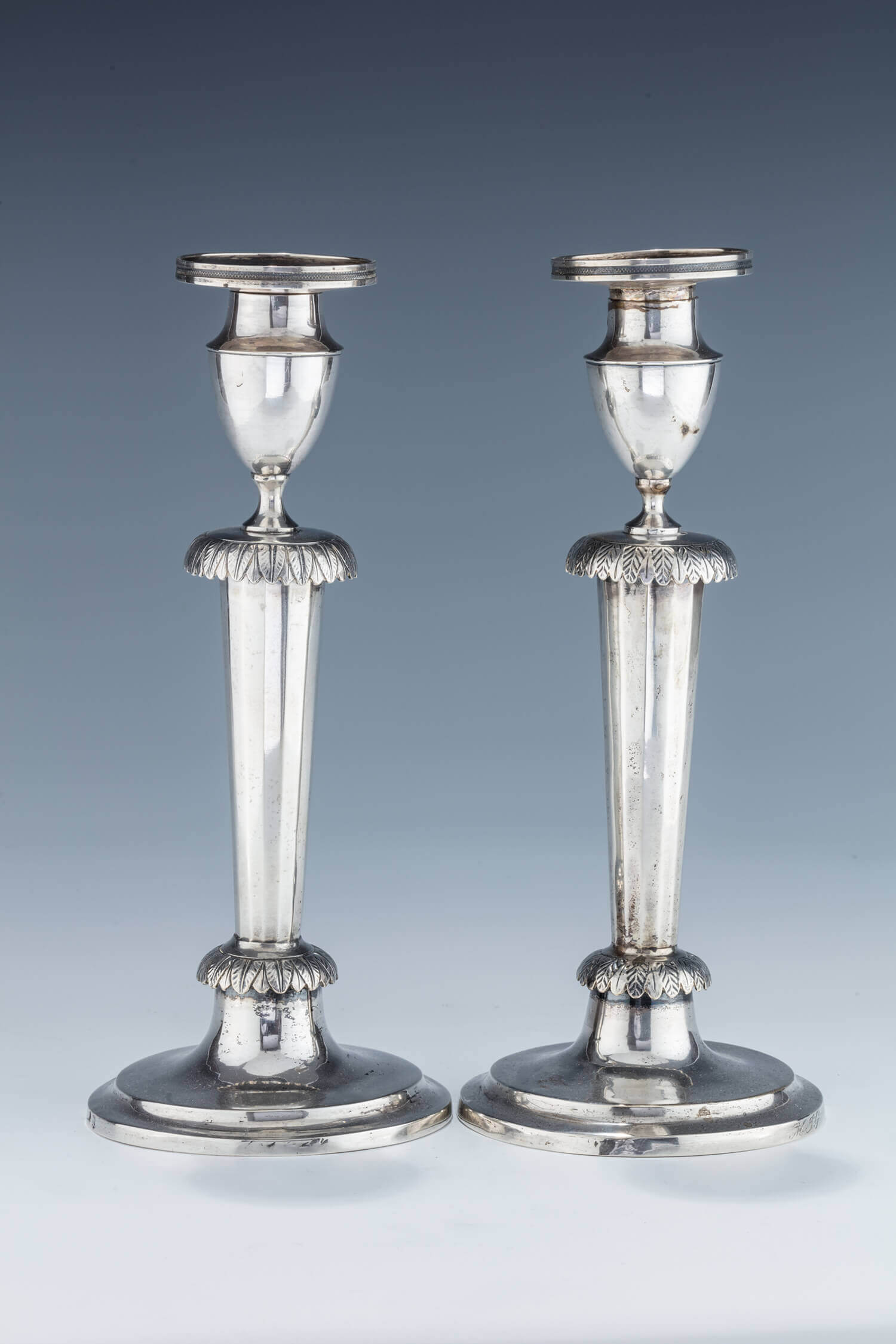 032. A PAIR OF SILVER CANDLESTICKS