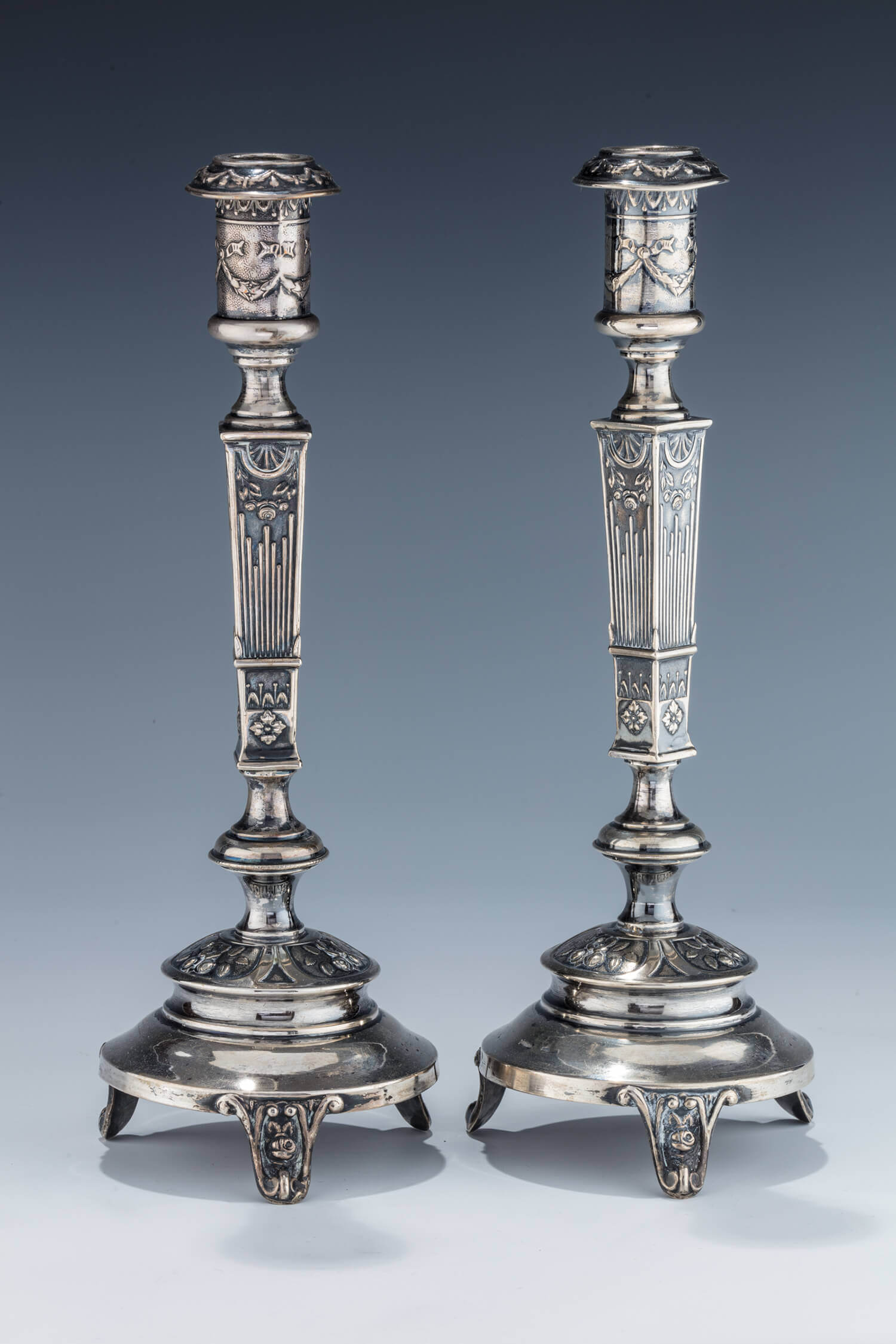 010. A PAIR OF SILVER CANDLESTICKS BY M