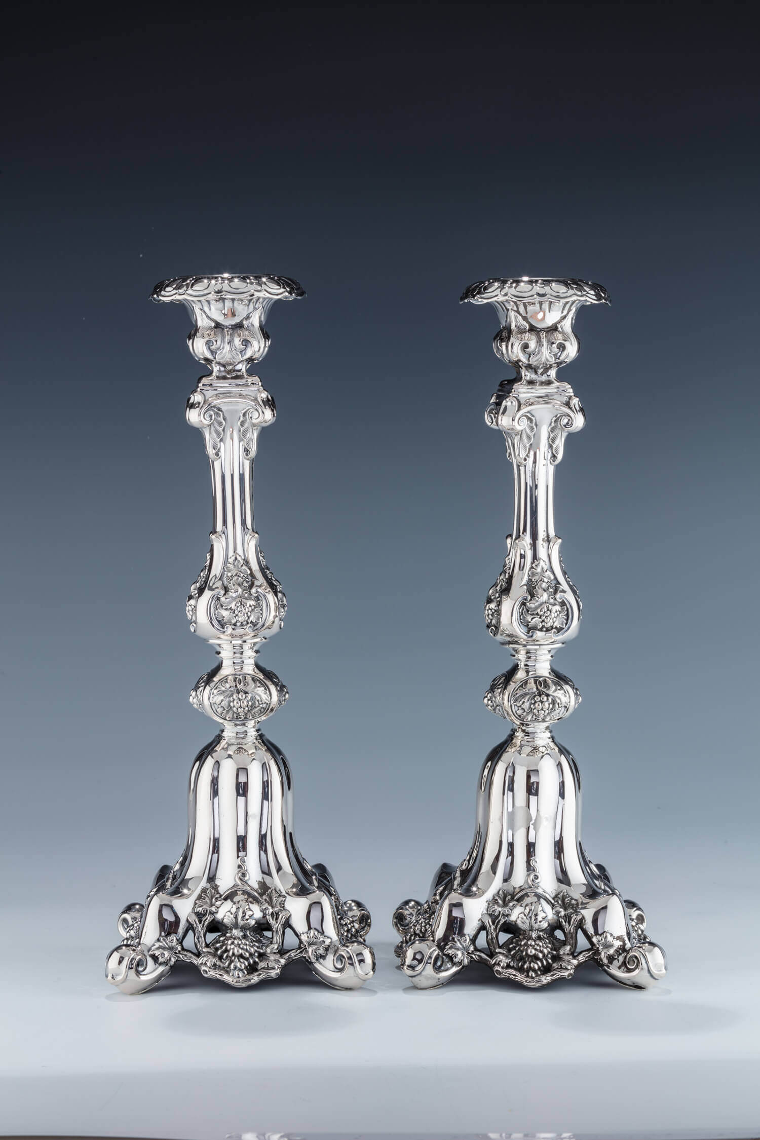 034. A PAIR OF LARGE SILVER CANDLESTICKS
