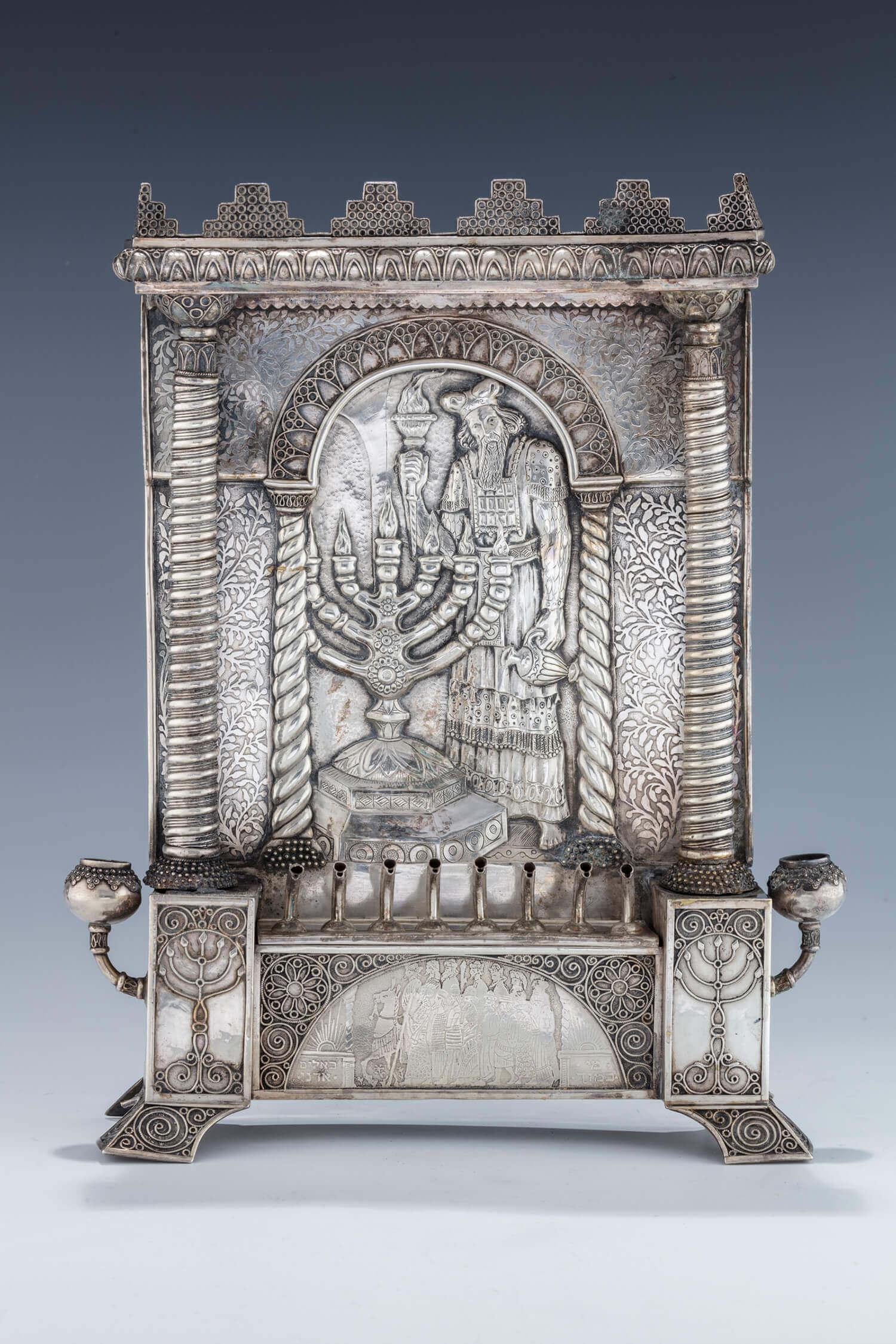 119. AN EXCEPTIONAL SILVER HANUKKAH LAMP BY THE BEZALEL SCHOOL
