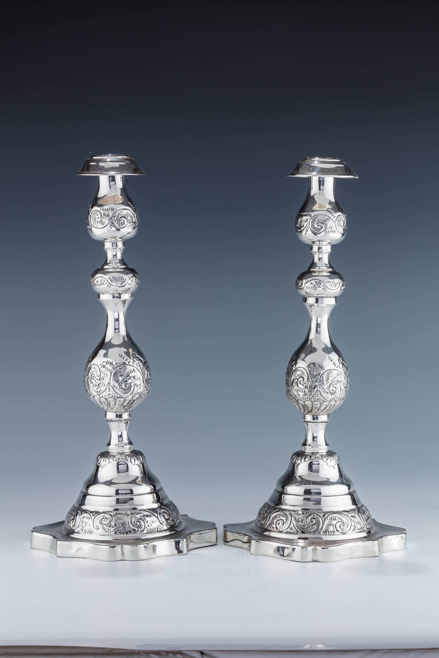 024. A MONUMENTAL PAIR OF STERLING SILVER SABBATH CANDLESTICKS BY MOSHE RUBIN