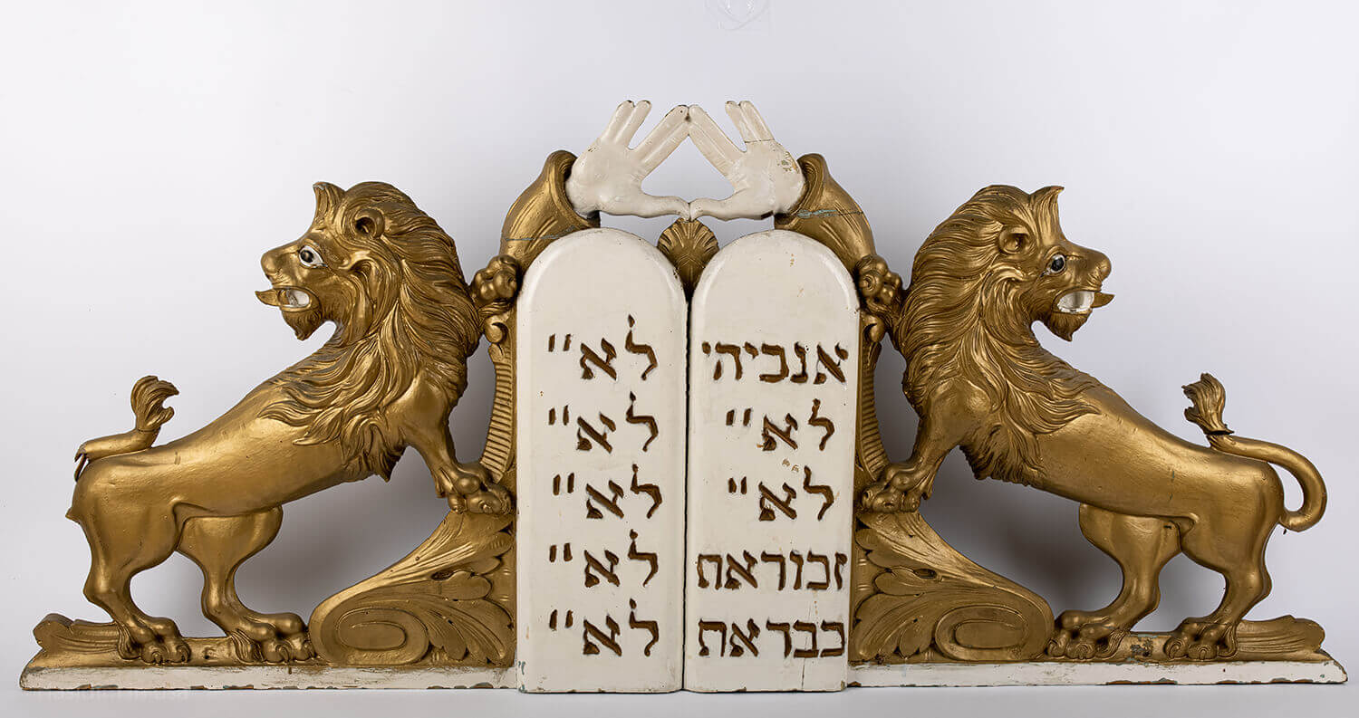 047. A LARGE PAIR OF WOODEN LIONS AND DECALOGUE
