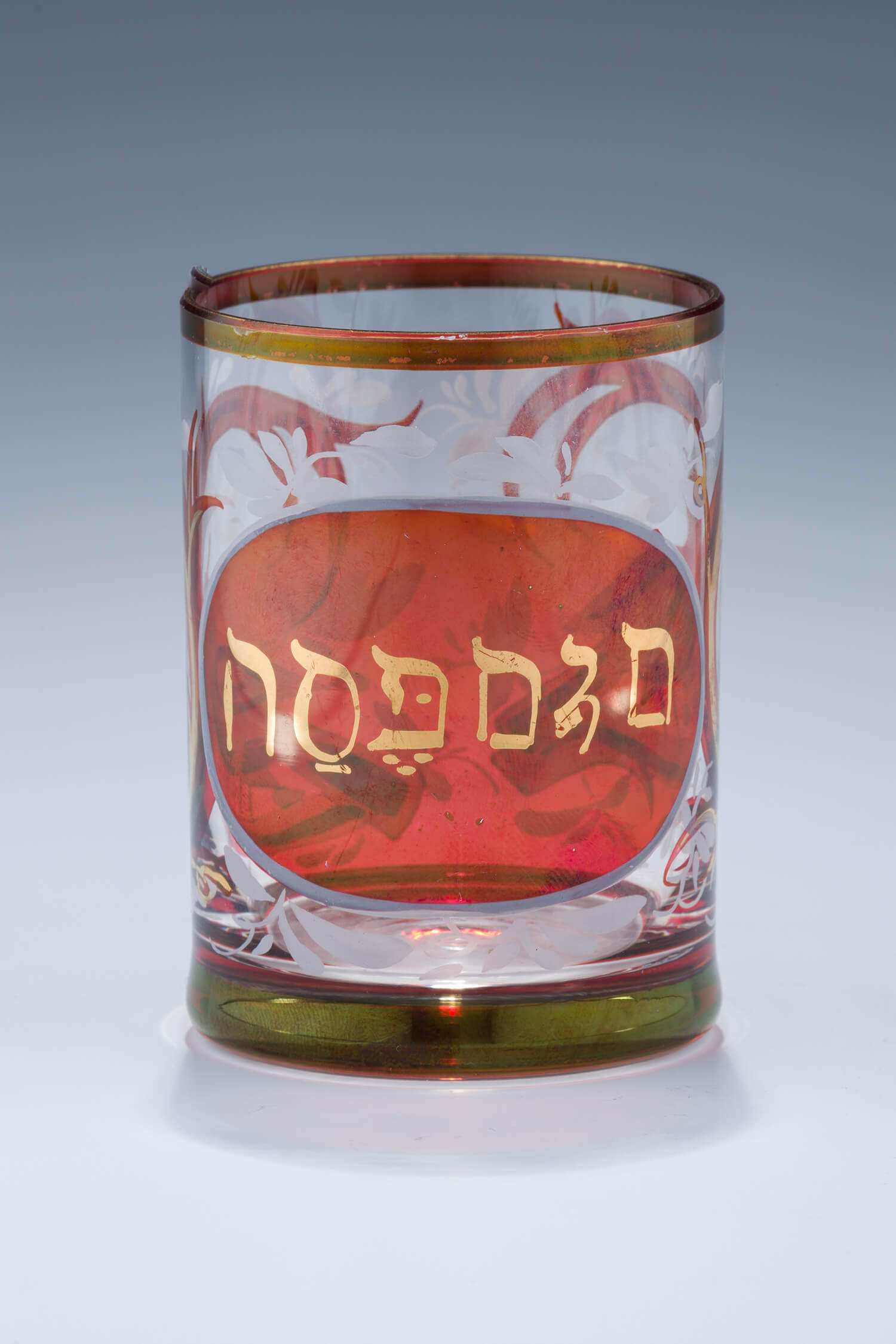 011. A RUBY COLORED PASSOVER BEAKER