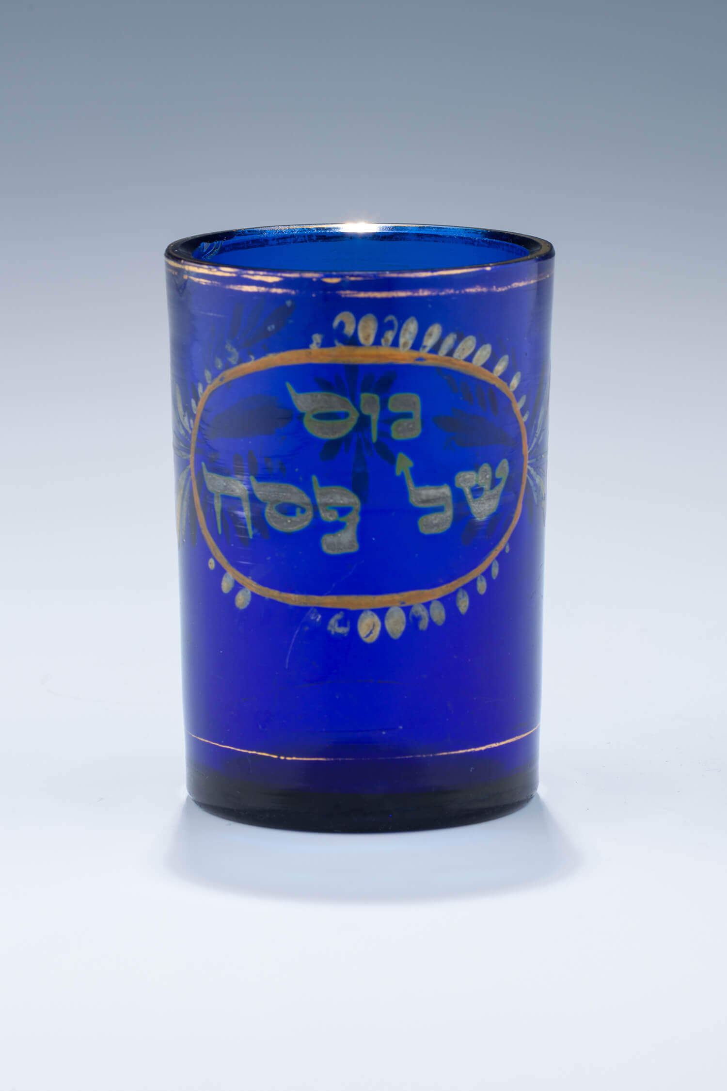 012. A BLUE GLASS PASSOVER BEAKER