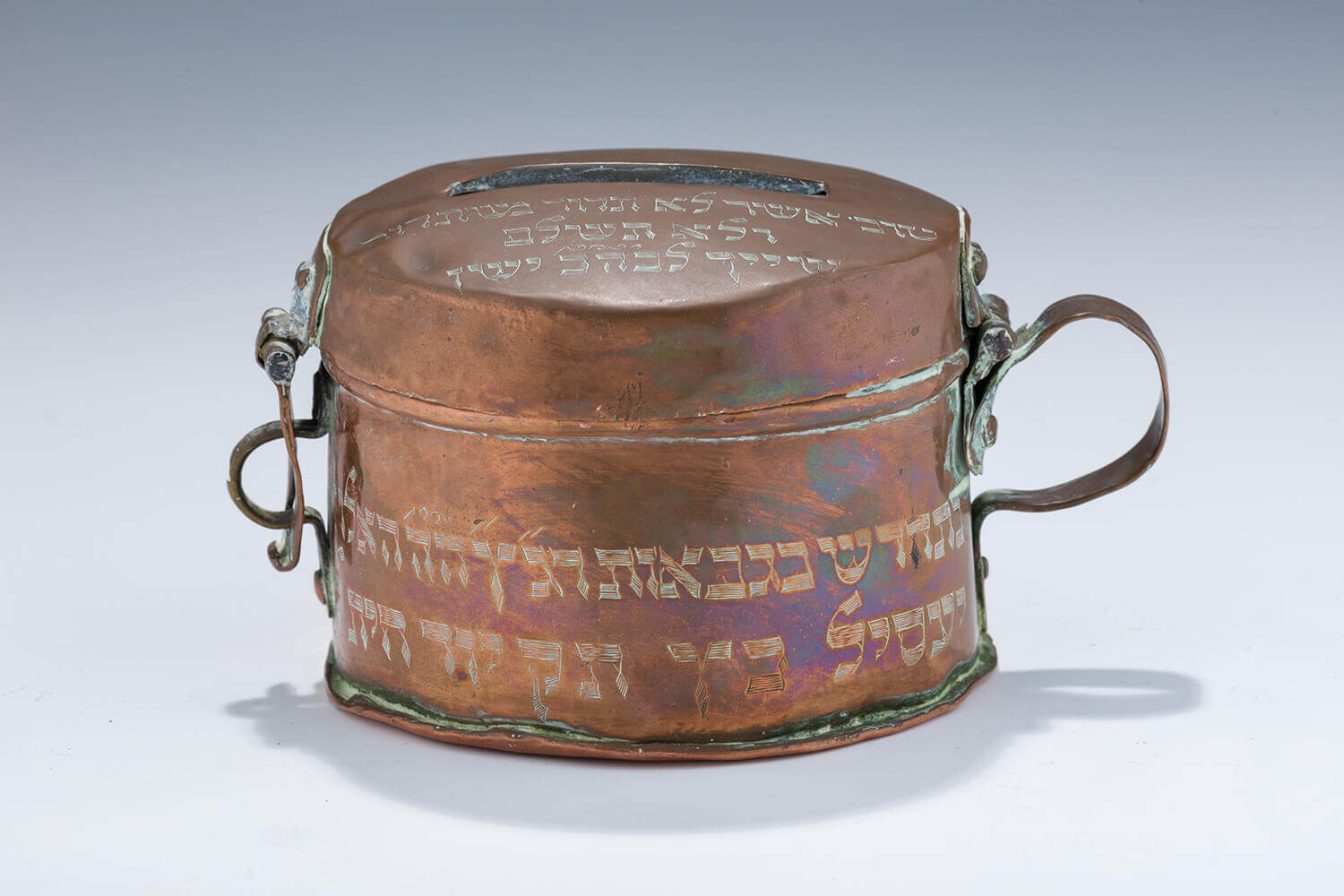070. A RARE AND IMPORTANT COPPER CHARITY CONTAINER