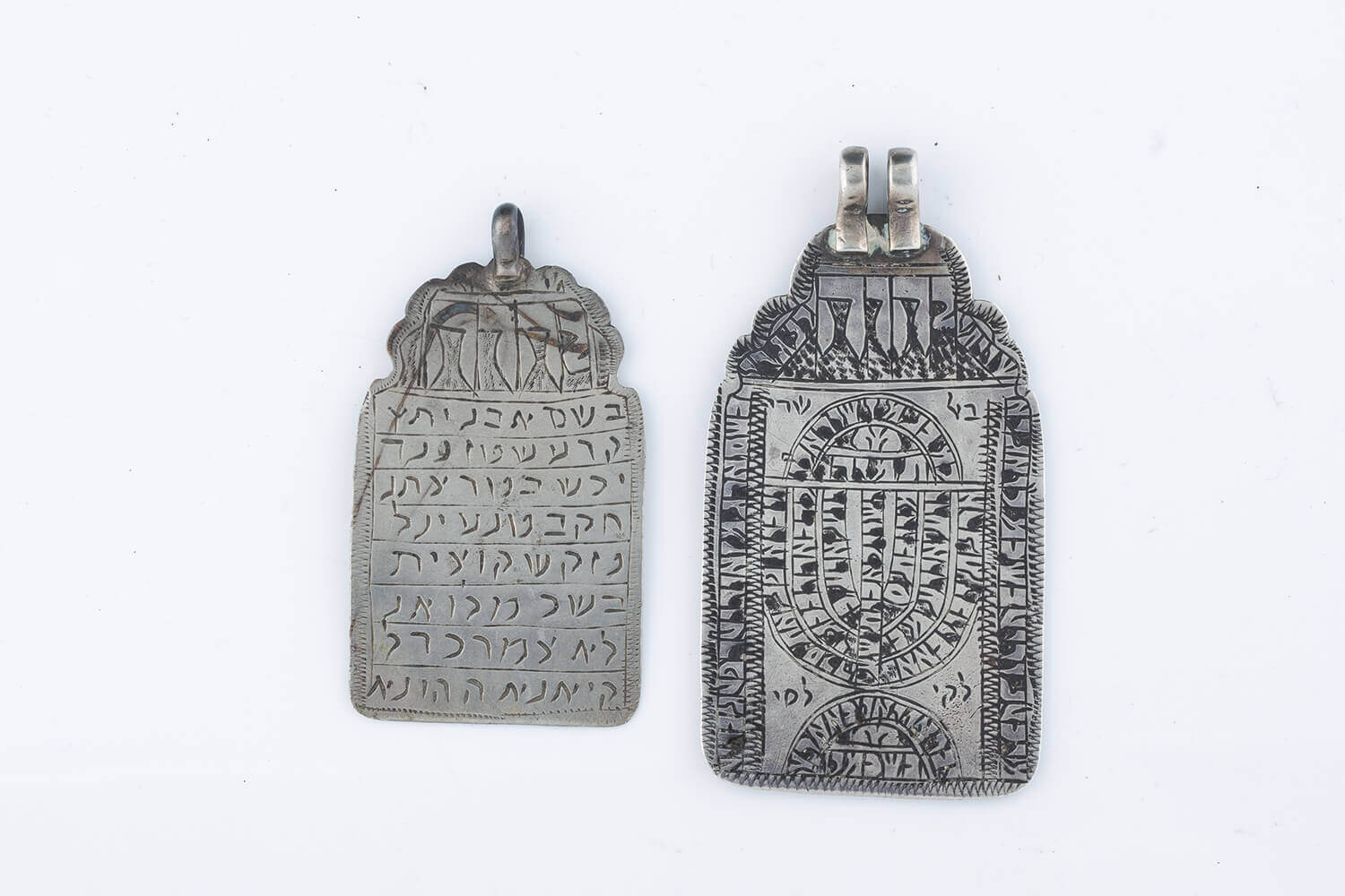 025. TWO SILVER TABLET FORM AMULETS