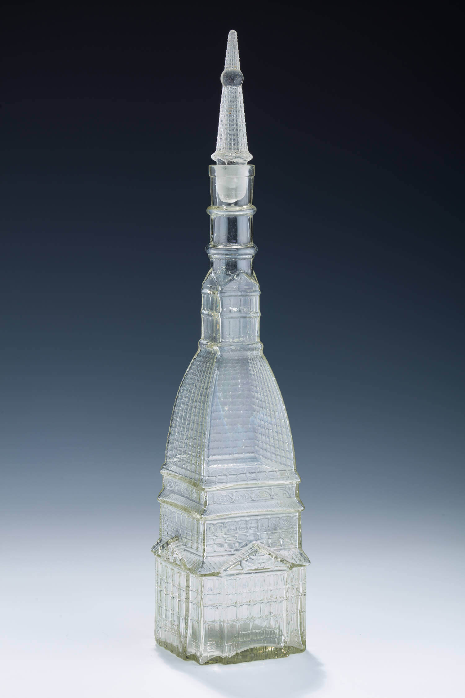 036. A LARGE GLASS WINE BOTTLE IN THE SHAPE OF THE TURIN SYNAGOGUE