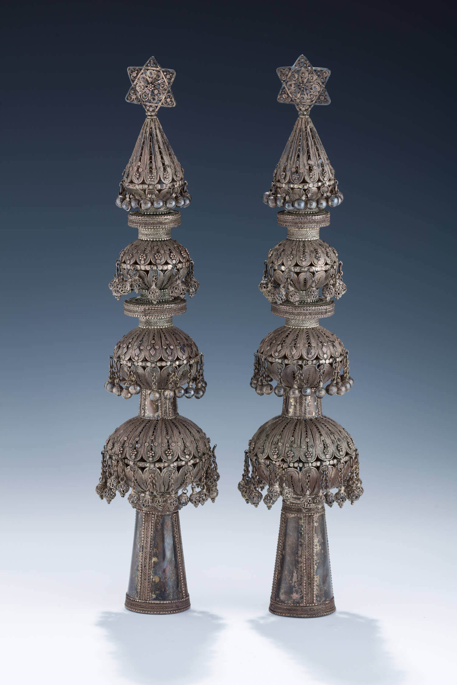 090. A PAIR OF SILVER TORAH FINIALS